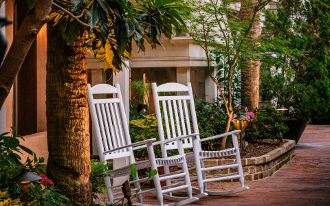 white rocking chairs outside