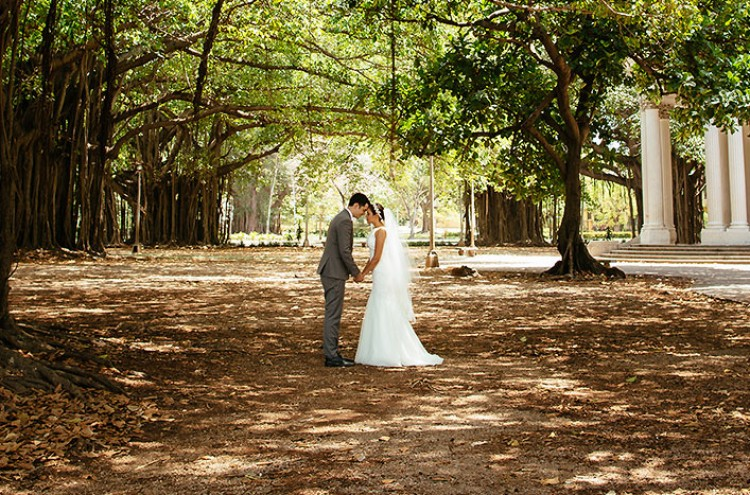 Bride and groom outside under trees