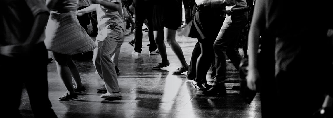 Bottom view of People legs dancing in black and white