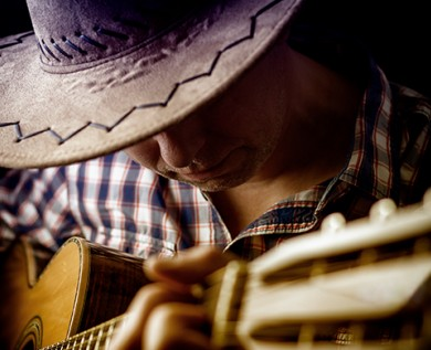 guitar player wearing a cowboy hat