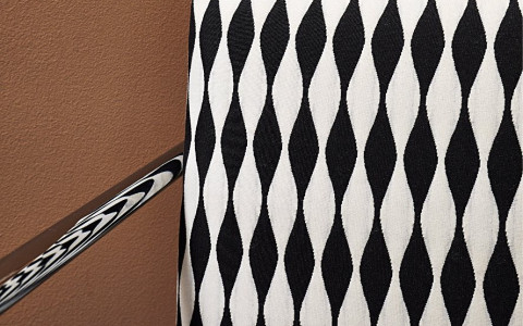 accent chair with black and white diamond pattern
