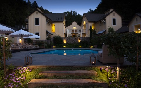 Farmhouse Inn Nighttime Pool and Exterior