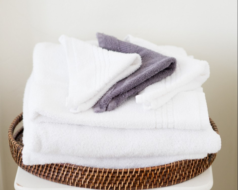 Small white stool with clean folded towels