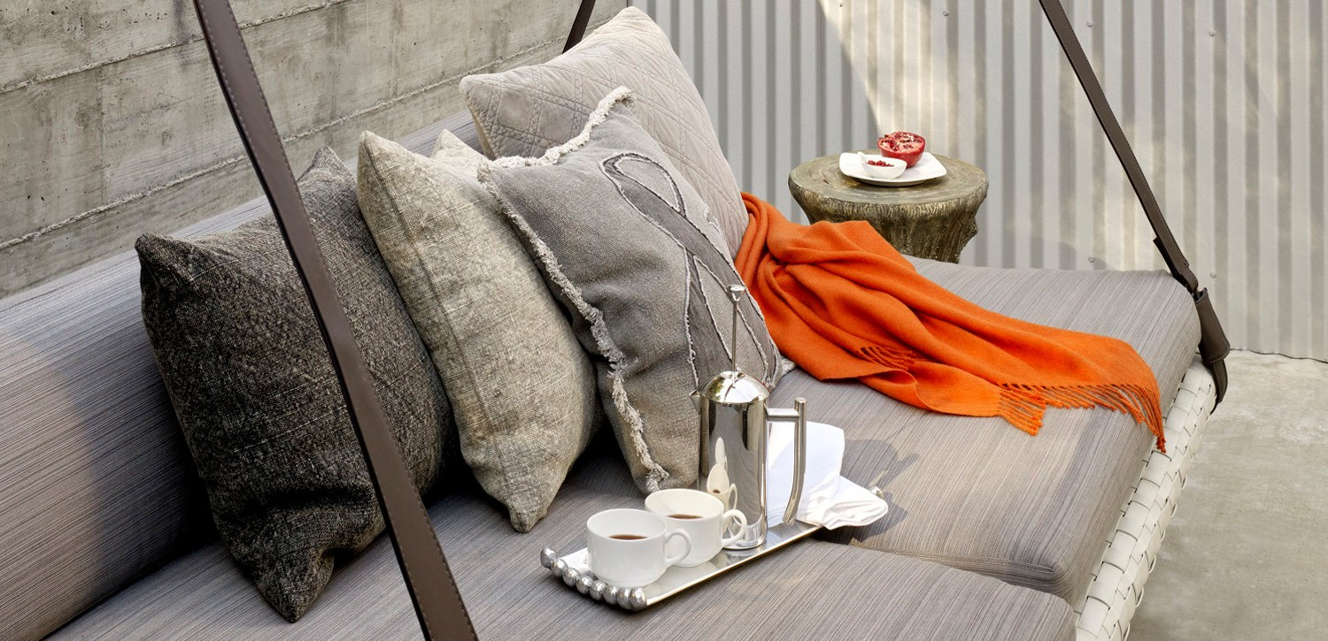 Patio swing cushioned chair with throw pillows & tray with coffee