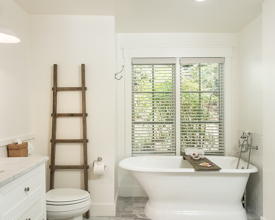 king cottage room bathroom with a white tub, shower and sink