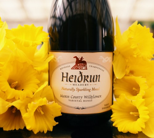 wine bottle next to yellow flowers-1