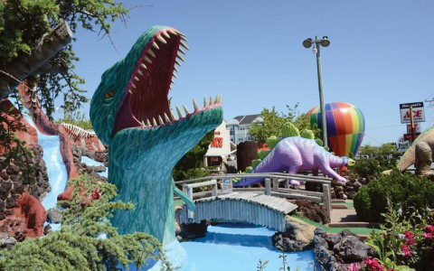 Lost Treasure minture Golf course features large colorful obstacles such as dinosaurs, hot air ballons and greenery
