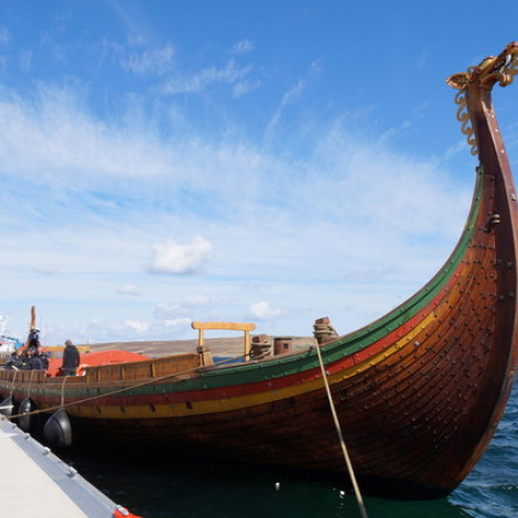 Viking Ship with Dragon Head docked on a modern dock