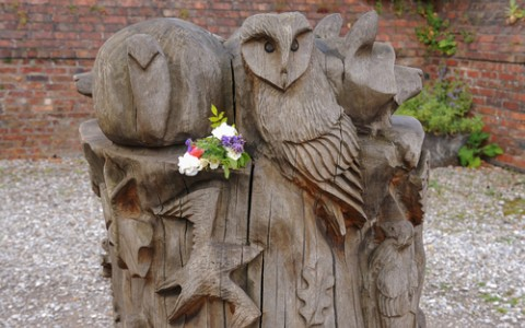 wooden sculpture of owls