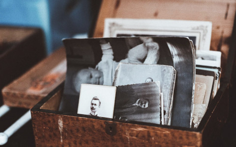 Wooden box with old black and white photographs