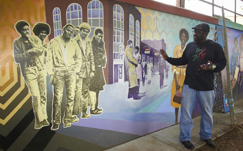 Man standing in front of a mural