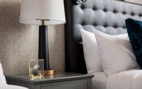 foundry room grey upholstered headboard and night stand with lamp