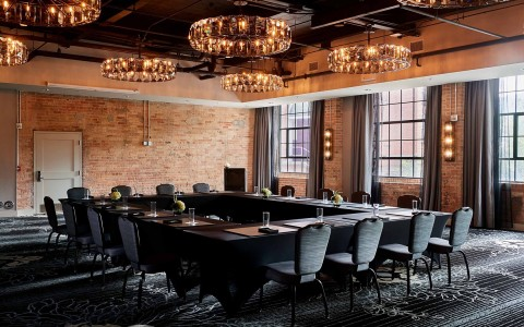 foundry events meetings space with square table and round chandeliers