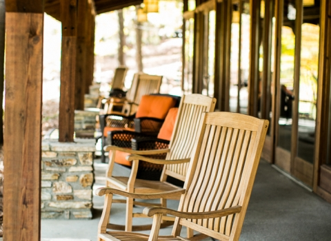 Wooden rocking chairs & sofa chairs on event room porch