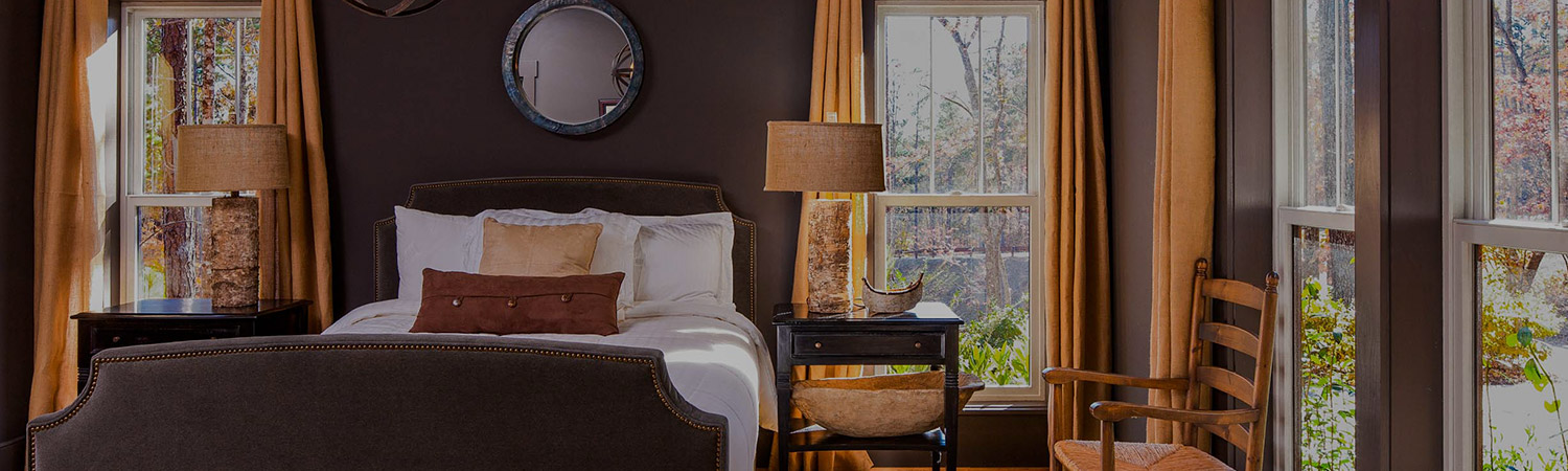 deluxe suite guest room with dark wood furniture