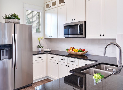 kitchen white cabinets stainless steel appliances