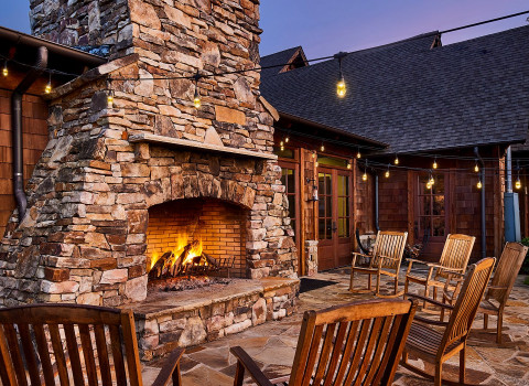 outdoor fireplace and wooden chairs