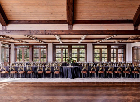 tables and chairs in indoor event space