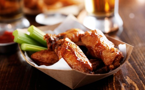 Wings and celery in a basket