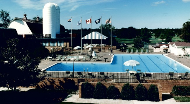 Vintage photo of large pool and flags of different countries