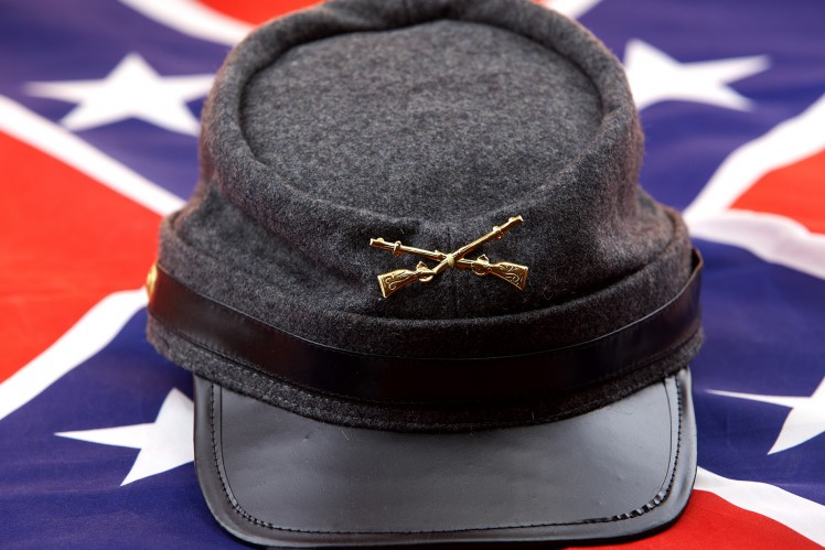 Hardee hat with symbol of gold symbol of crossed rifles on a confederate flag