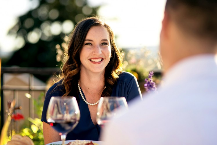 Couple enjoying two glasses of red wine in the evening outdoors