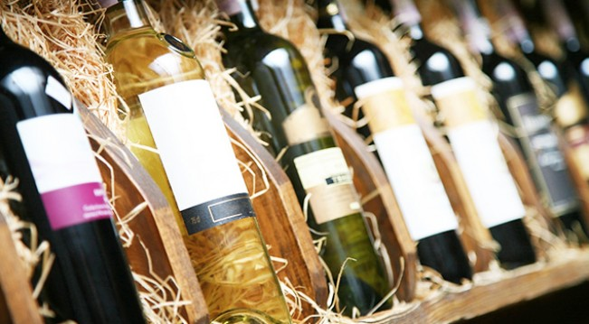 Wine bottle in crates with hay