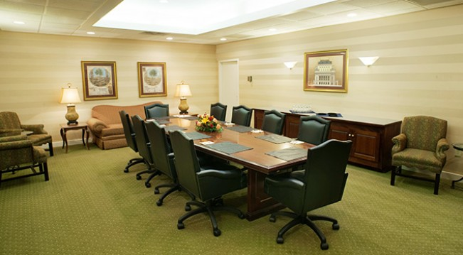 Conference room with long table and chairs