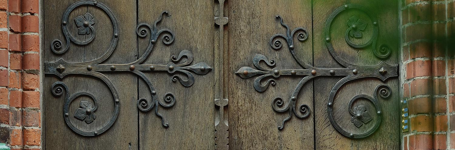 old wooden door with iron details