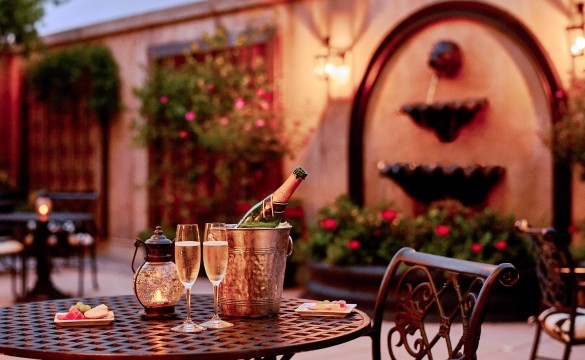 bottle of champagne on a table in the courtyard
