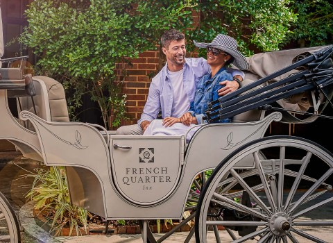 Couple laughing and sitting in a carriage