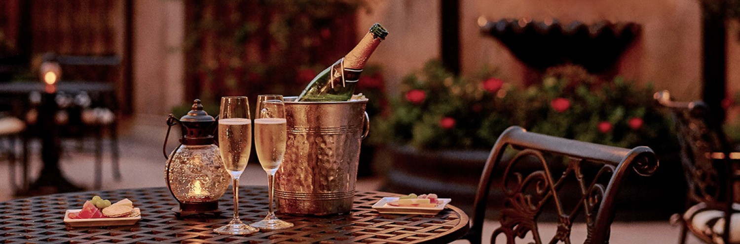 Beautiful outdoor table with champagne