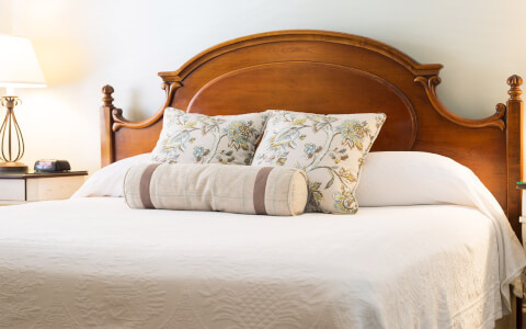 king bed with detailed accent pillows