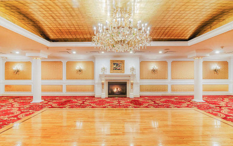 ballroom with wood dance floor and fireplace