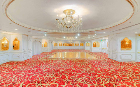 ballroom with white walls and red carpet