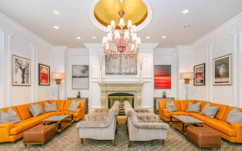 lobby with orange sofas and fireplace