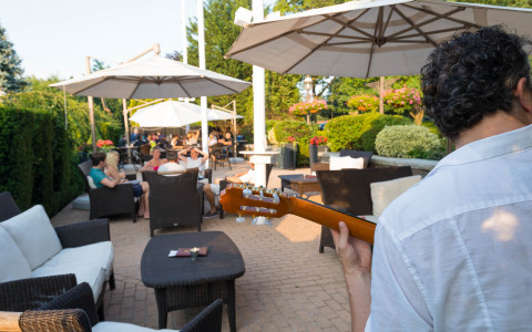 patio bar with tables and outdoor heaters and live music