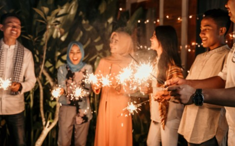group of friends holding sparklers