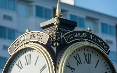 Clock tower that says The Garden City Hotel
