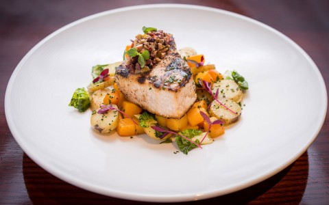 Salmon filet with mixed vegetables on top