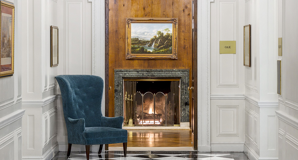 The Glen Cove Mansion entryway and fireplace