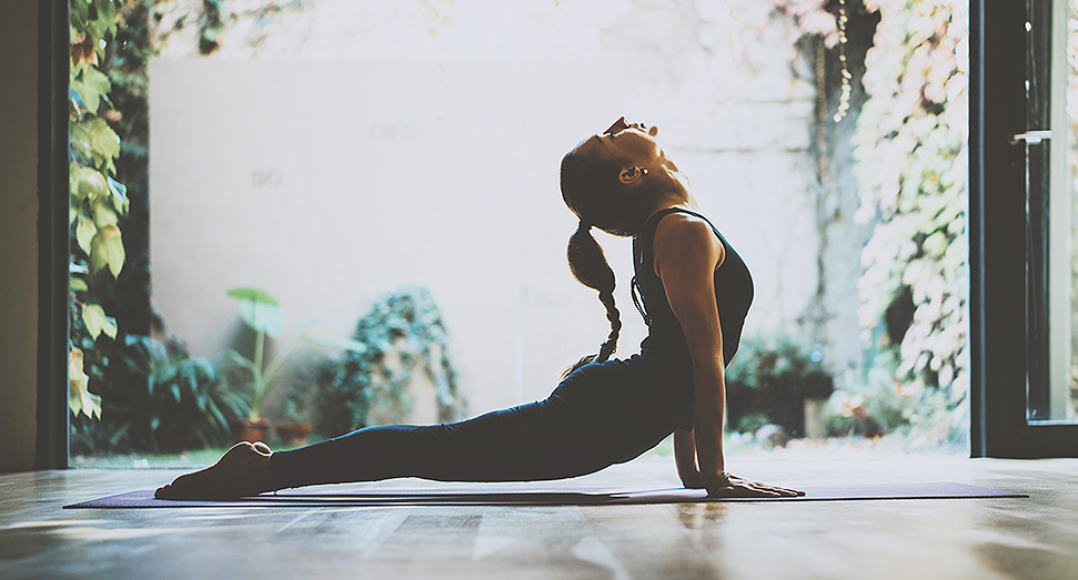 Woman in downward dog yoga pose