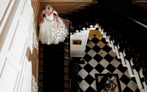 Aerial view of bride walking down staircase