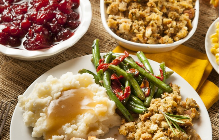 Thanksgiving dinner with turkey, potatoes, stuffing & green beans