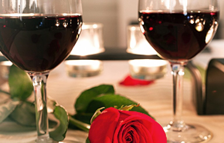 Two glasses of red wine with rose