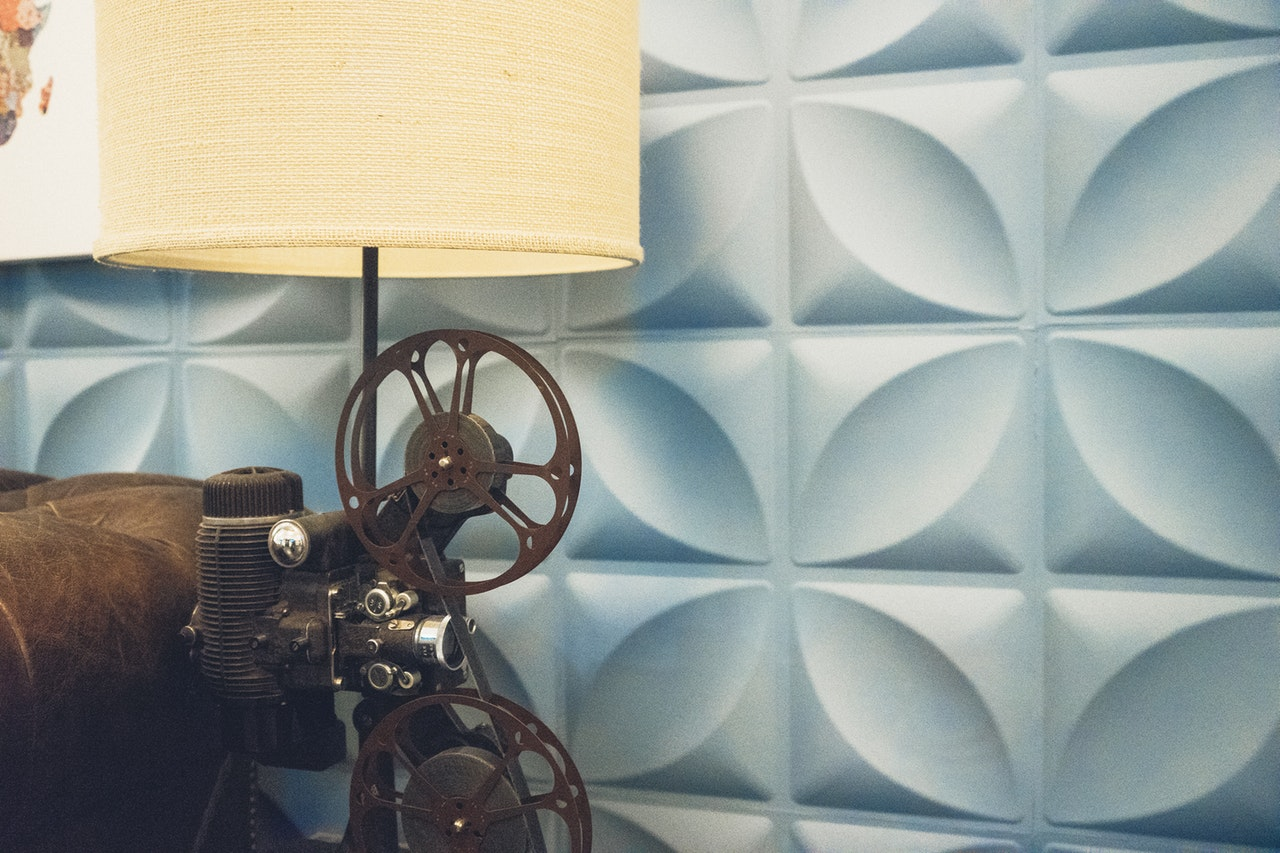 Vintage motion picture projector in retro living room