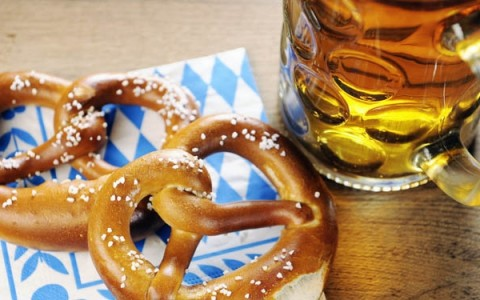 close up of a soft pretzel and beer mug