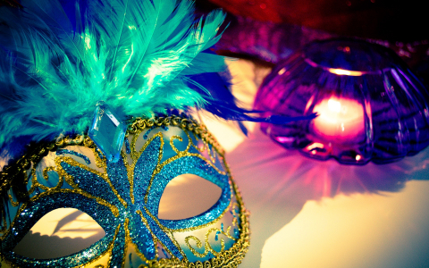 Turquoise venetian mask with feathers