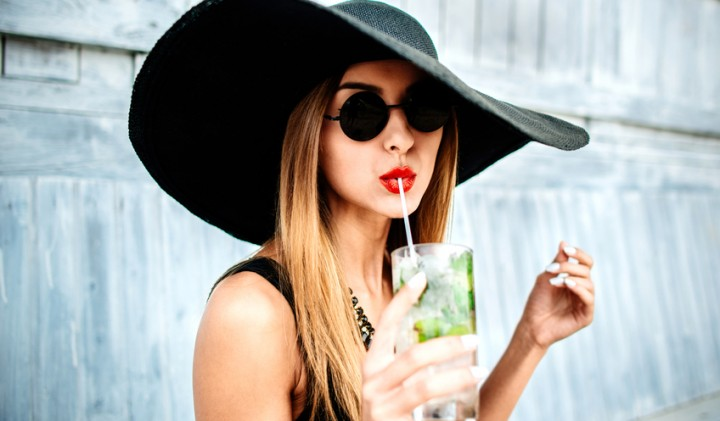 young attractive woman in a black floppy hat with a cocktail-579be18b38865.jpg