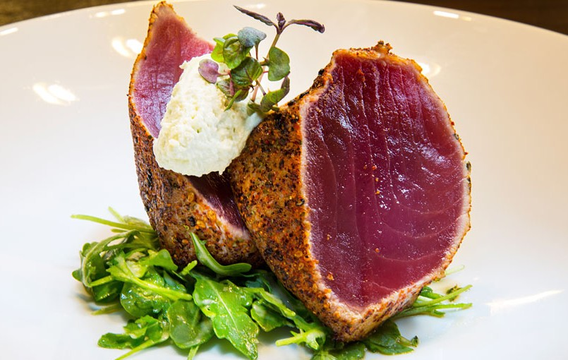 seared tuna dish on a bed of greens